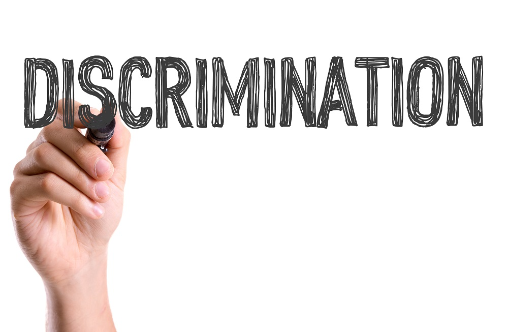 Hand with marker writing: Discrimination